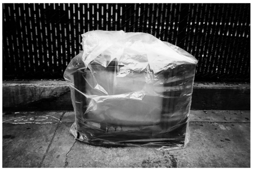TV, plastic wrapped, Apr14